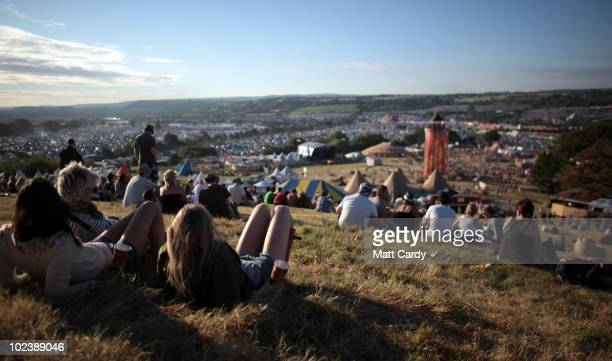 People enjoy the sun weather at the Glastonbury Festival site at Worthy Farm Pilton on June 24 2010 in Glastonbury England ating its 40th anniversary