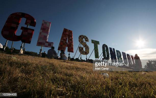 People enjoy the sunny weather at the Glastonbury Festival site at Worthy Farm Pilton on June 24 2010 in Glastonbury England The gates opened...