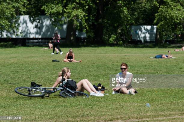 People enjoy the sunny weather in Clapham Common in southwest London as high temperatures continue ahead of the Bank Holiday weekend on 21 May 2020...
