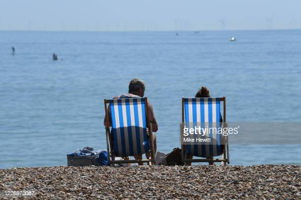 People enjoy the sunny weather on Brighton beach on May 25, 2020 in Brighnton, England. The British government has started easing the lockdown it...
