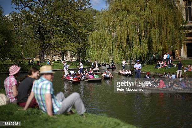People enjoy the sunshine and punt on the River Cam on May 6 2013 in Cambridge England High temperatures are being experienced by many in southern...