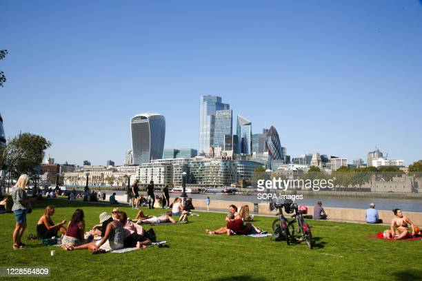 People enjoy the sunshine in Potters Fields Park as mini heatwave continues in London.