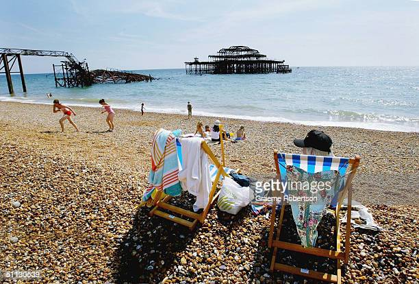 People enjoy the sunshine on Brighton beach July 30 2004 in Brighton England The United Kingdom is set for soaring temperatures this weekend as a...