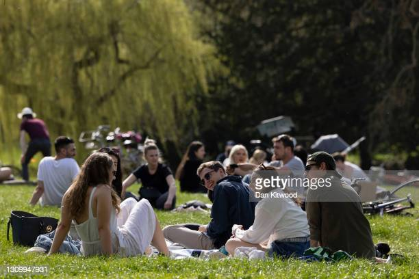 People enjoy the sunshine on March 30, 2021 in Cambridge, England. Forecasters are predicting temperatures of 22C and with the easing of pandemic...
