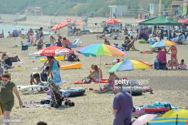 People enjoy the sunshine on the beach at ClactononSea in Essex as the heatwave continues in parts of the UK with forecasted highs of 37C