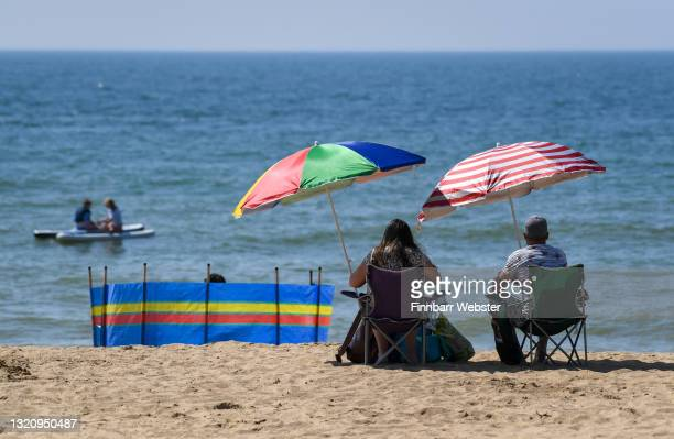 People enjoy the sunshine on the beach on May 31, 2021 in Bournemouth, England.