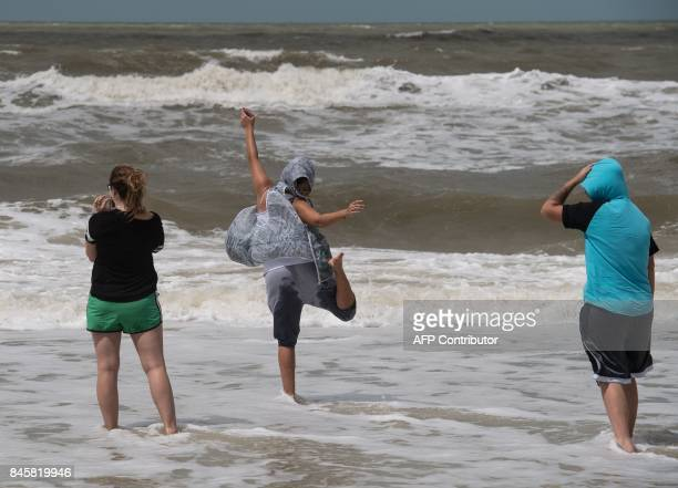 People enjoy the surf in Naples Florida on September 11 2017 after Hurricane Irma hit Florida Millions of Florida residents were without power and...