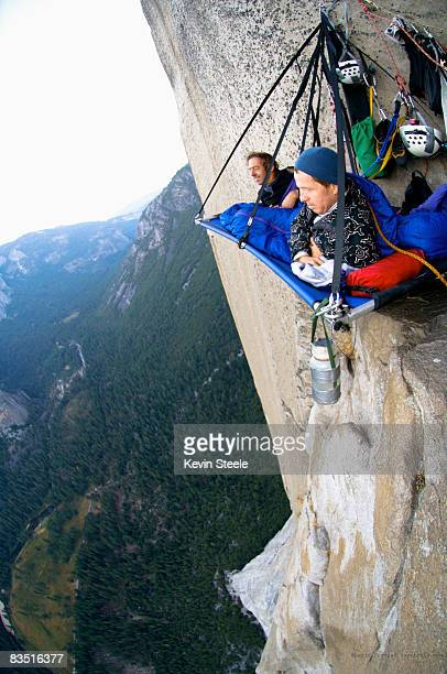 People enjoy  the view from a small ledge on El Capitan, Yosemite Valley, California.