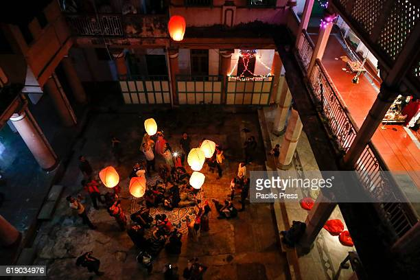 People enjoy the view of hand made paper balloons flying during traditional Diwali Light Balloon Festival also called Phanushndia Fanush paper made...