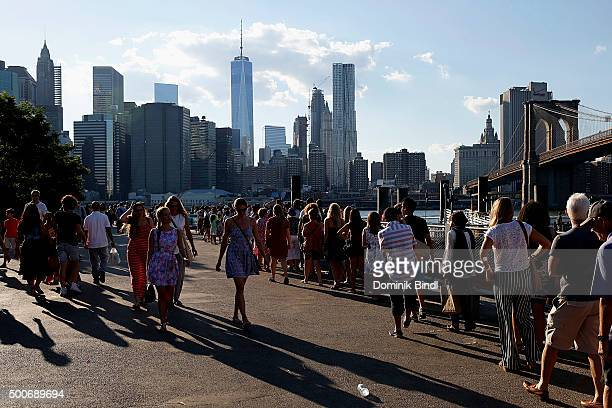 People enjoy the view on Brooklyn Bridge Financial District and One World Trade Center as seen from Brooklyn Bridge Park on August 03 2015 in New...
