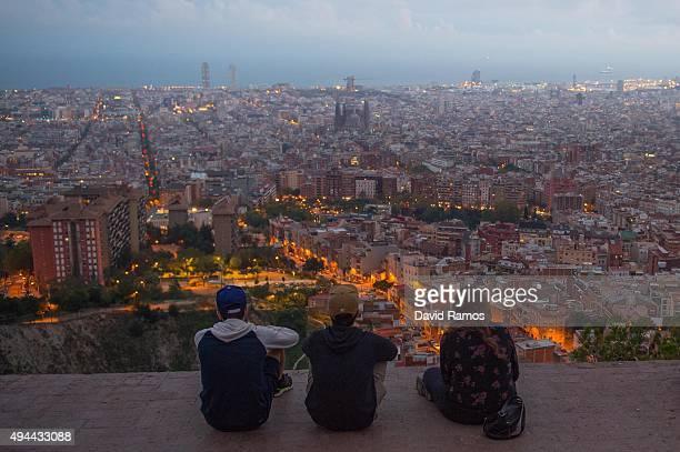 People enjoy the view over the city with 'La Sagrada Familia' in the background on October 26 2015 in Barcelona Spain 'La Sagrada Familia' Foundation...