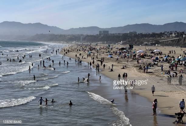 People enjoy the warm weather on Santa Monica beach on April 30, 2021 in Santa Monica, California.