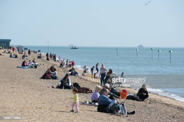 People enjoy the warm weather on the beach on March 29, 2021 in Southend, England. Today the government eased its rules restricting outdoor...