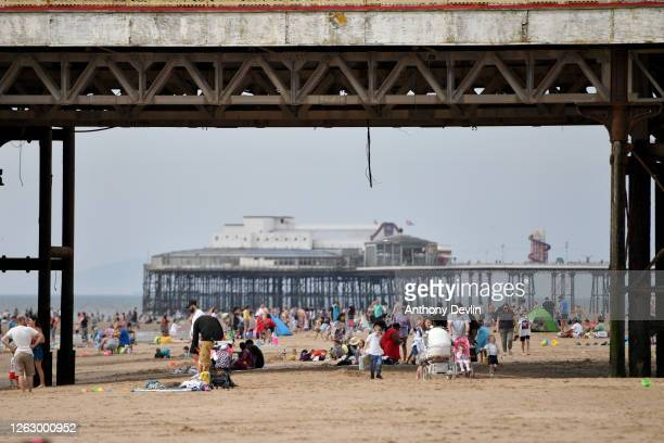People enjoy the warm weather on the Blackpool Beach on July 31 2020 in Blackpool England High temperatures are forecast across the UK today with...