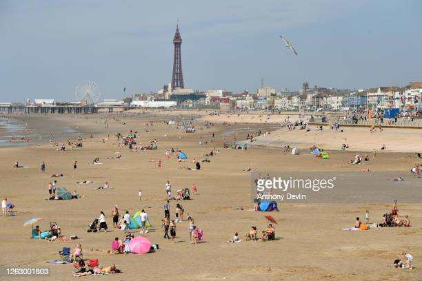 People enjoy the warm weather on the Blackpool Beach on July 31, 2020 in Blackpool, England. High temperatures are forecast across the UK today, with...