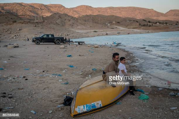 People enjoy the waters edge at lake Dukan ahead of the upcoming referendum for independence of Kurdistan on September 23 2017 in Sulaymaniyah Iraq...