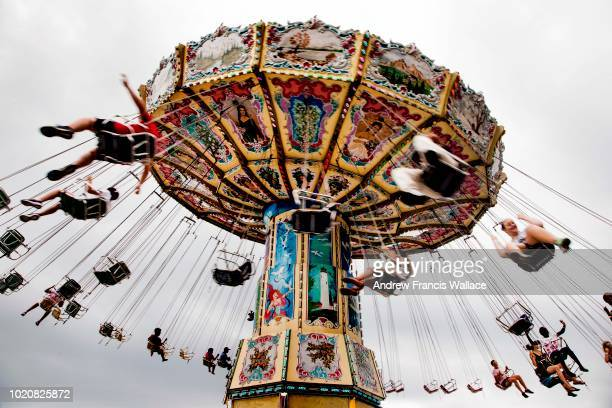 People enjoy the Wave Swinger during Opening Day of the CNE