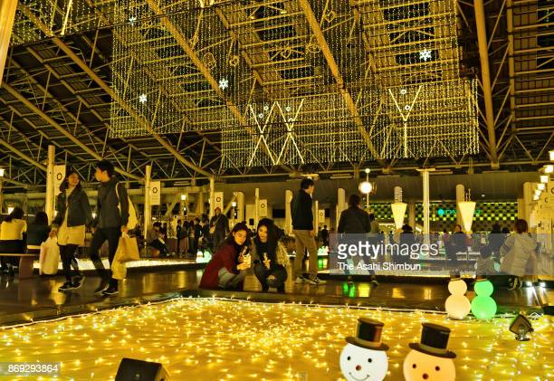 People enjoy the winter illumination at JR Osaka Station on November 1 2017 in Osaka Japan
