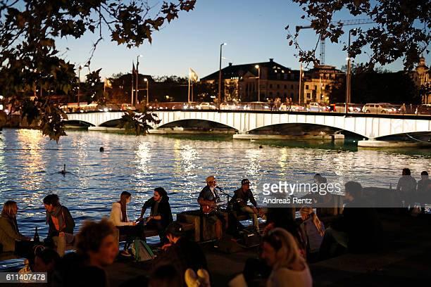 People enjoy their evening along the Limmat river during the 12th Zurich Film Festival on September 29 2016 in Zurich Switzerland The Zurich Film...