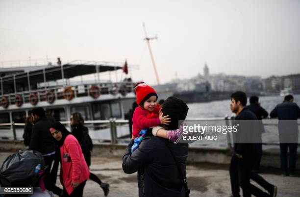 People enjoy their evening at Eminonu in Istanbul on April 6 10 days ahead of the referendum on whether to change the current parliamentary system...