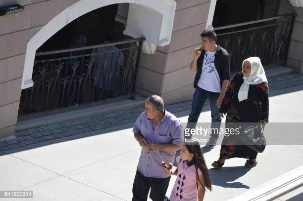 People enjoy their holiday by visiting the Haci Bayrami Veli Mosque and its around on the second day of Muslims' sacrificial festival Eid alAdha in...