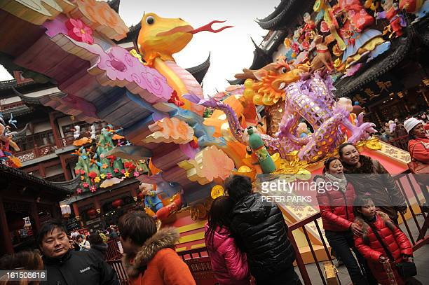 People enjoy their Lunar New Year holidays in Shanghai on February 12 2013 The Lunar New Year typically marks the largest annual movement of people...