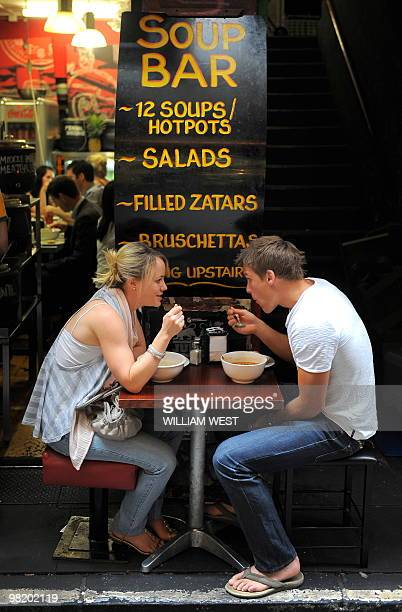 People enjoy their lunch in one of Melbourne's innercity laneways which is home to many vibrant bars cafes restaurants boutiques sushi bars and shops...