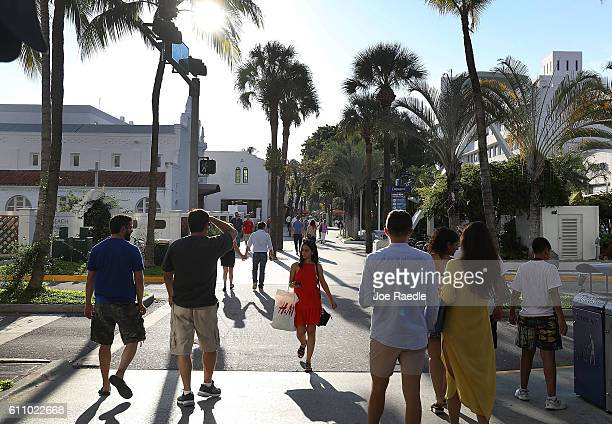 People enjoy themselves along Lincoln Road, an open air shopping space, on the day officials released the locations of the sites where Zika virus was...