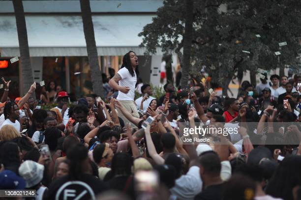 People enjoy themselves along Ocean Drive on March 19, 2021 in Miami Beach, Florida. College students have arrived in the South Florida area for the...