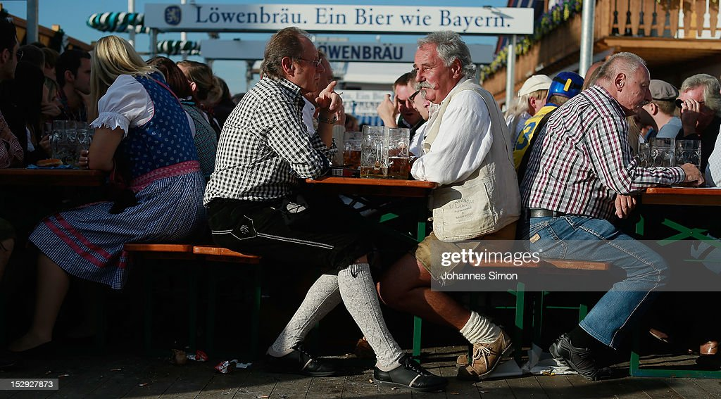 People enjoy themselves as they drink beer outside Loewenbraeu beer tent during day 7 of Oktoberfest beer festival on September 28, 2012 in Munich, Germany.This year's edition of the world's biggest beer festival Oktoberfest will run until October 7, 2012.