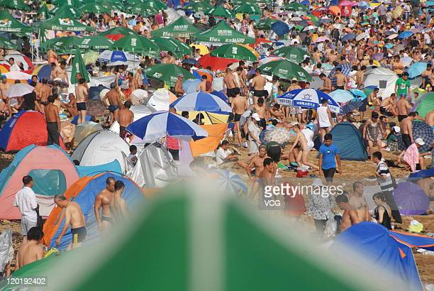 People enjoy themselves at a beach on July 31 2011 in Dalian Liaoning Province of China The temperature reached 28 degrees with 80% relative humidity