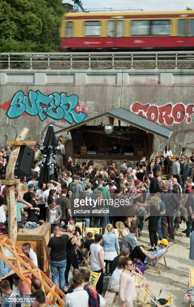People enjoy themselves at Club Magdalena during the music festival 'Fete de la musique' in BerlinGermany 21 June 2015 Photo Joerg Carstensen/dpa |...
