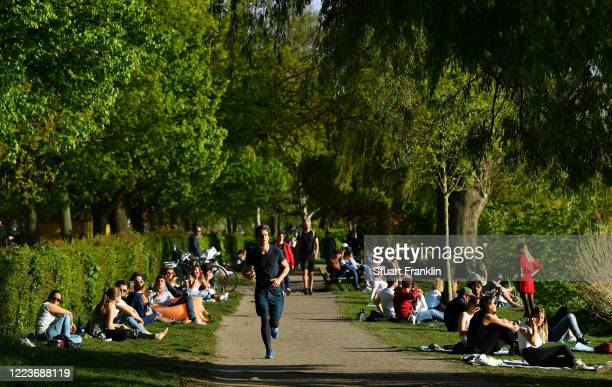 People enjoy themselves by the Alster during the coronavirus crisis on May 08 2020 Hamburg Germany German states that contain popular holiday...