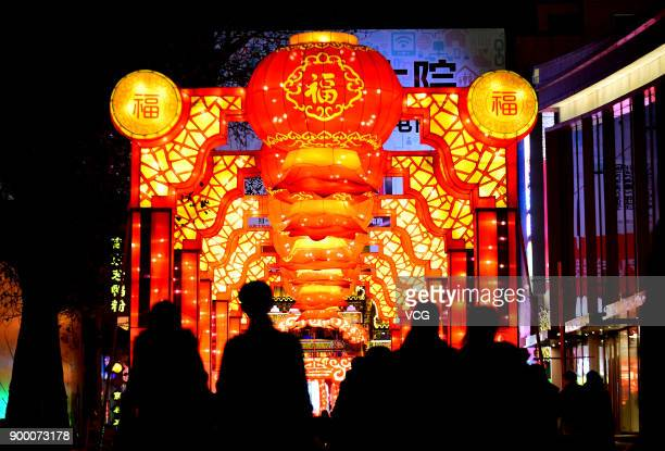 People enjoy themselves during a lantern show to celebrate new year on December 30 2017 in Shenyang China