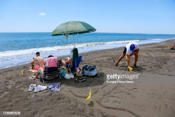 People enjoy Velez beach parcelled to keep the distance between users during the first day of Phase 2 of deescalation due to Covid19 where bathing...