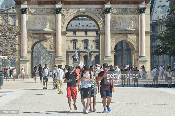 People enjoy visits in the Tuileries Garden near the Arc de Triomphe du Carrousel as very hot weather continues in Paris and this will remain for the...