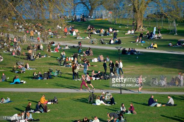 People enjoy warm and springlike weather with high temperatures on April 22 in Stockholm Sweden has not imposed the extraordinary lockdown measures...