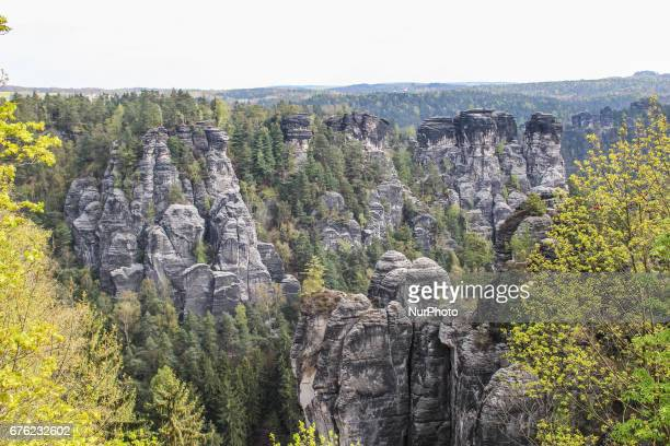 People enjoy warm but windy weather visisting the Bastei rock formation in Saxon Switzerland National Park nera the Rathen and Pirna in Germany on 1...