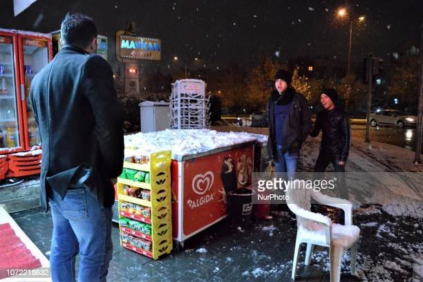 People enjoy watching a heavy snowfall in the winter season in Ankara Turkey on December 12 2018