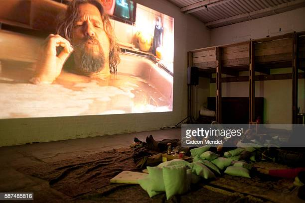 People enjoy watching the cult film The Big Lebowski at the The Yard Theatre in Hackney Wick close to the site of the 2012 Olympic Games The unusual...