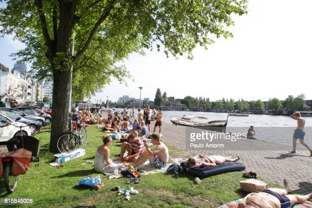 People Enjoyinf the Summer at Amstel River in Amsterdam