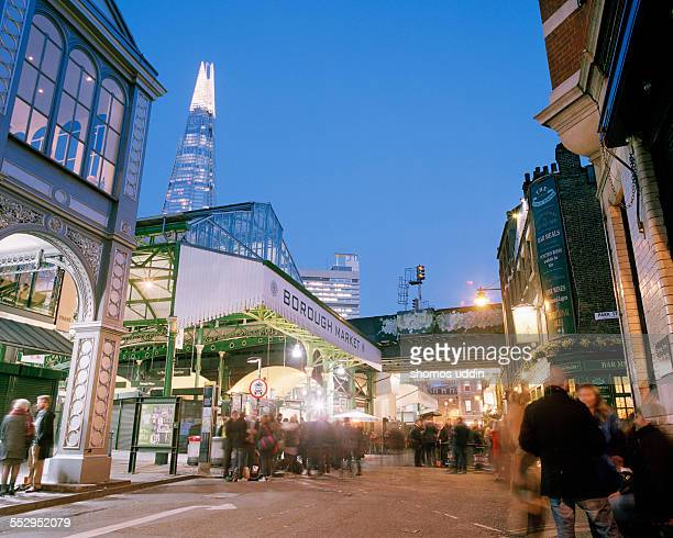 people enjoying a drink outside borough market - borough market stock pictures, royalty-free photos & images