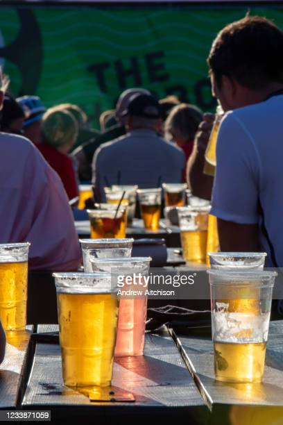 People enjoying a few drinks during the Euro 2020 semi final match between England and Denmark on the 7th of July 2021 at the outdoor screen at...