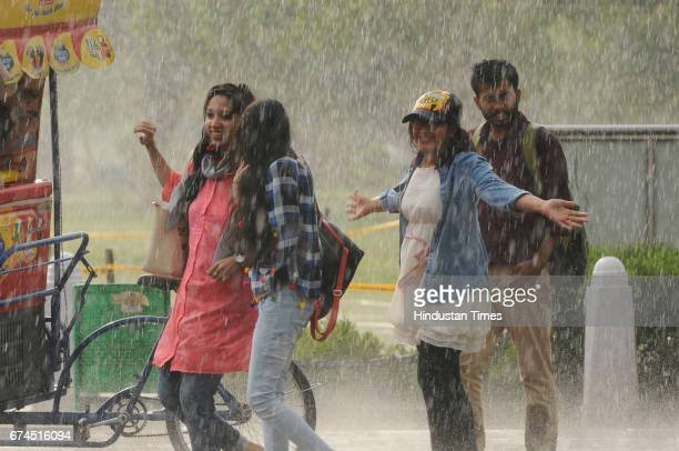 People enjoying a sudden downpour near India Gate on April 28 2017 in New Delhi India