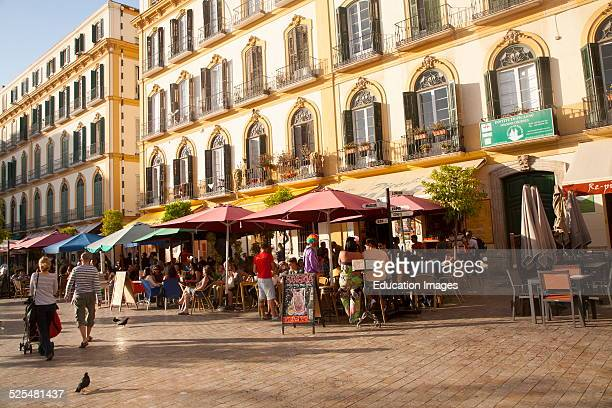 People enjoying a sunny spring afternoon in bars on the Plaza de la Merced Malaga Spain