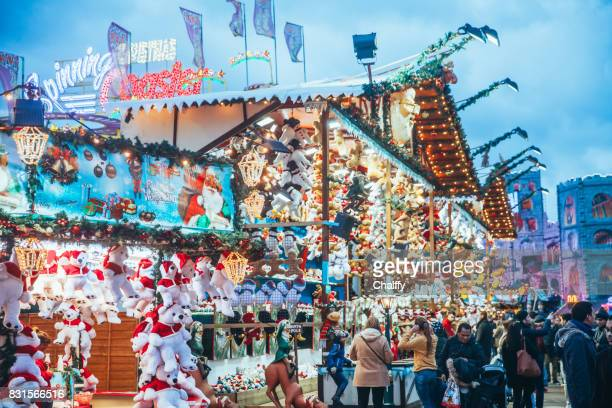 people enjoying a winter wonderland in hyde park, london - hyde park london stock photos and pictures