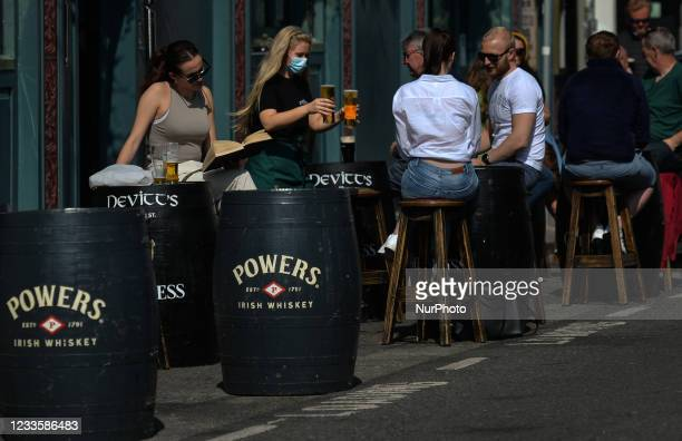 People enjoying afternoon drinks outside a pub in Dublin center. On Monday, 21 June 2021, in Dublin, Ireland.