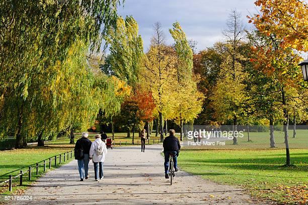 People enjoying an autumn day in Englischer Garten, Munich