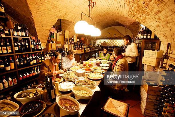 People Enjoying Antipasti in Restaurant
