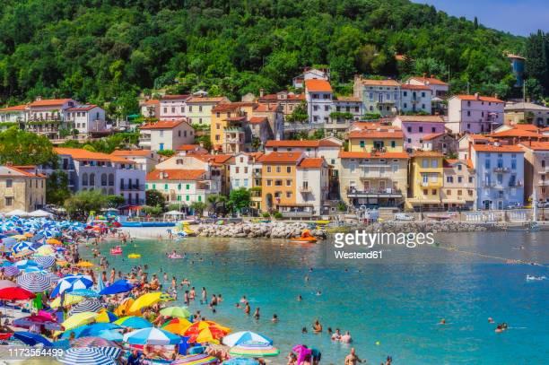 people enjoying at beach by opatija town during summer - croacia fotografías e imágenes de stock